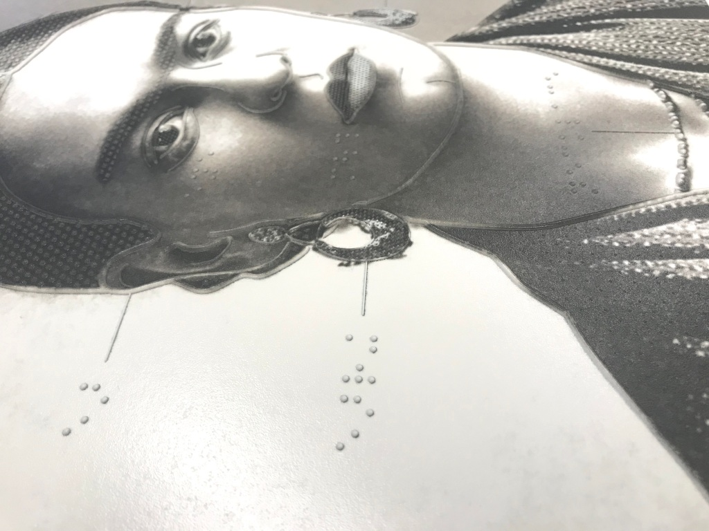 detail of UV-printed tactile drawing of Frida Kahlo with outlines and labels