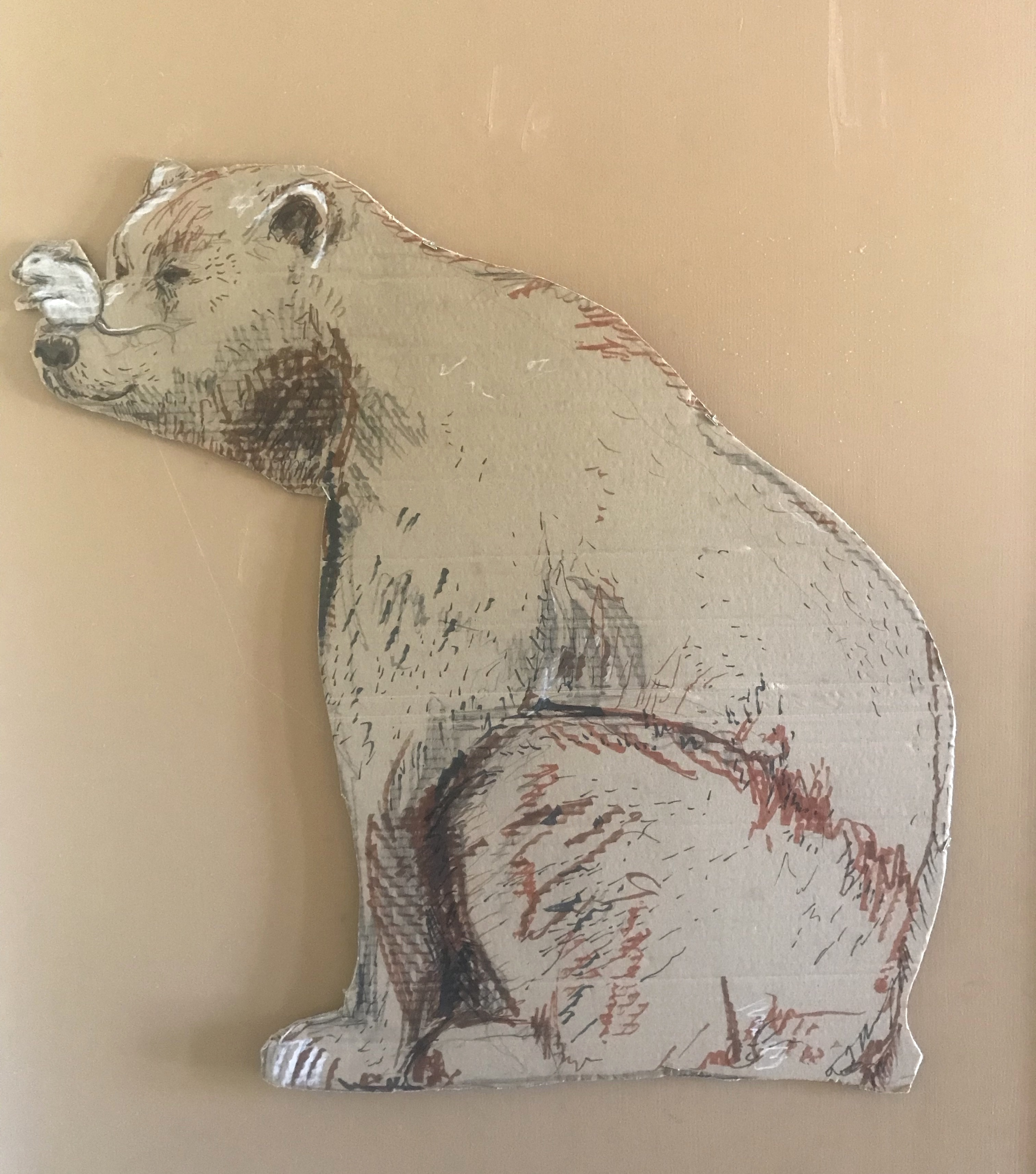 bear with mouse on nose, cut out and drawn on cardboard, hanging on wall
