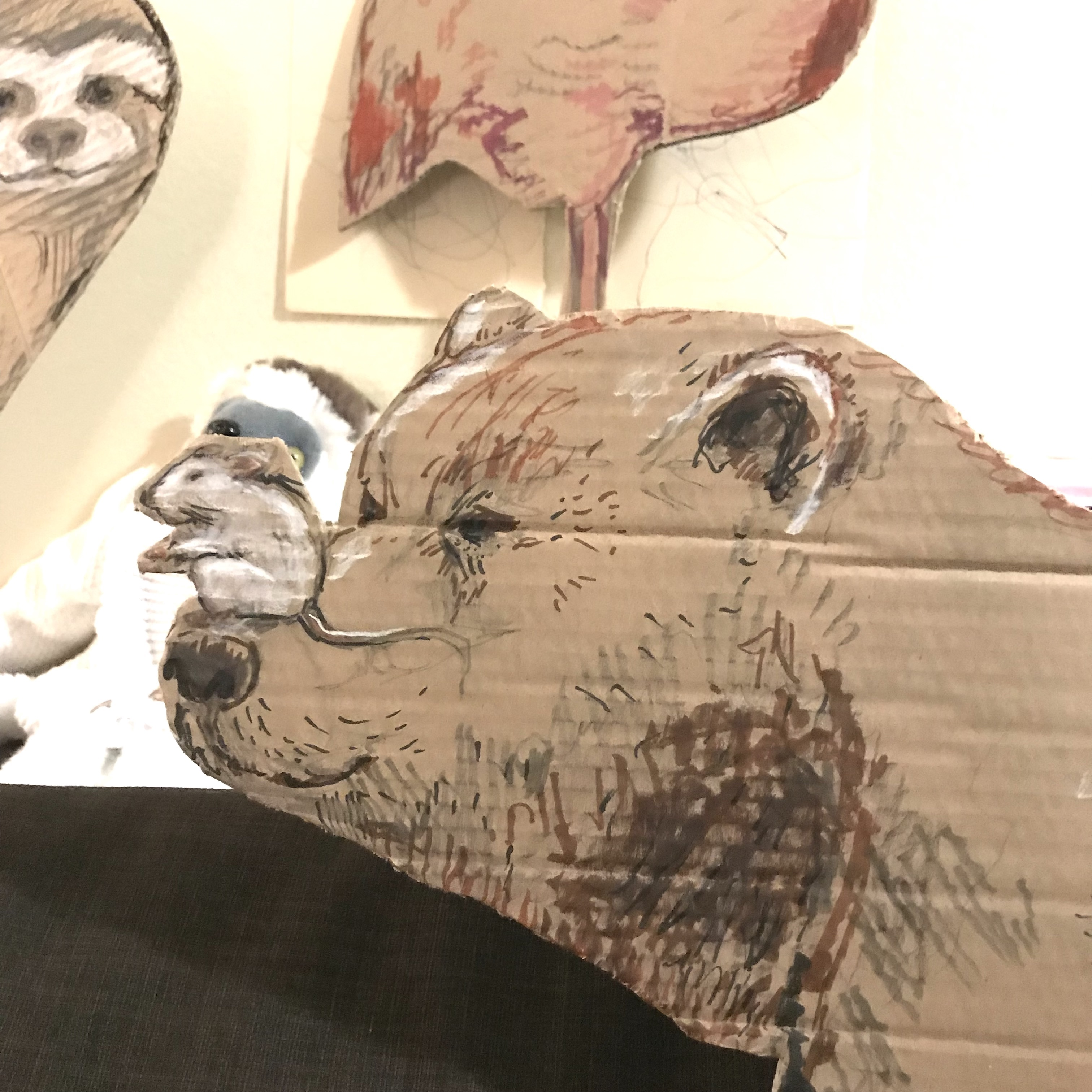bear head with mouse on nose, cut out and drawn on cardboard