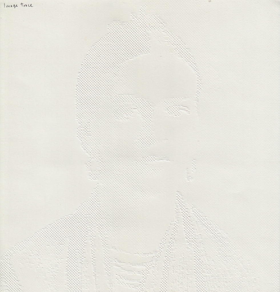 embossed paper tactile drawing of Frida Kahlo showing light and dark composition
